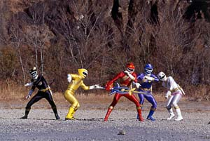 Wild Force Rangers stand to battle with the Jungle Sword